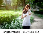 young tired woman wiping her... | Shutterstock . vector #1107181415