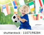 child watching football game on ... | Shutterstock . vector #1107198284
