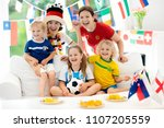 family with children watching... | Shutterstock . vector #1107205559