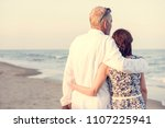 a senior couple on the beach | Shutterstock . vector #1107225941