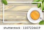 green tea leaves on wooden ... | Shutterstock .eps vector #1107226619