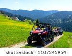 a tour group travels on atvs... | Shutterstock . vector #1107245954