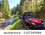a tour group travels on atvs... | Shutterstock . vector #1107245984