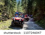 a tour group travels on atvs... | Shutterstock . vector #1107246047