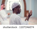 two religious muslim man... | Shutterstock . vector #1107246074