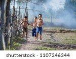 kids runing in rural thailand...   Shutterstock . vector #1107246344