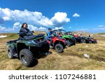 friends driving off road with...   Shutterstock . vector #1107246881