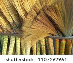 a pile of bamboo brooms in... | Shutterstock . vector #1107262961