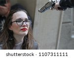 Small photo of Person attacked woman with a gun. Cruelly invaded women, violence concept. Victim of gun attack. Woman face a gun. Robber, thief point a gun to a woman. PTSD and suicide prevention, mental health.