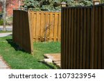 damaged wooden fence | Shutterstock . vector #1107323954