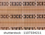 packed and stacked bricks.... | Shutterstock . vector #1107334211