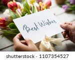 best wishes card with a bouquet | Shutterstock . vector #1107354527