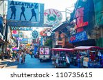 PATTAYA, THAILAND - MARCH 13: Walking street on March, 2012 in Pattaya. Walking Street  is a popular tourist attraction. Almost 20 million tourists visited Thailand in 2011. - stock photo