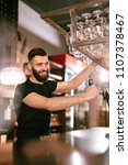 bar pub. male bartender... | Shutterstock . vector #1107378467