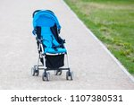 Small photo of Empty blue baby stroller in a park - Missing child concept