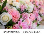 artificial rose flowers mixed... | Shutterstock . vector #1107381164