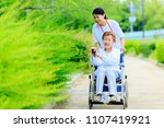 elderly female wheelchair and... | Shutterstock . vector #1107419921