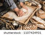baker's hands kneading raw... | Shutterstock . vector #1107424931