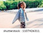 playful woman wraps herself... | Shutterstock . vector #1107426311