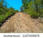 long stony road. countryside.... | Shutterstock . vector #1107435875