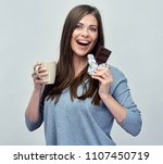 smiling young woman holding... | Shutterstock . vector #1107450719