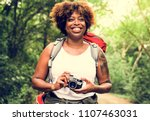 woman with an analog camera | Shutterstock . vector #1107463031