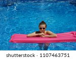 woman standing in swimming pool ... | Shutterstock . vector #1107463751