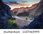 rider in green jacket at... | Shutterstock . vector #1107465995