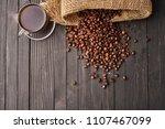 coffee beans from bag mug    ...   Shutterstock . vector #1107467099
