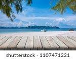 wooden desk or plank on sand... | Shutterstock . vector #1107471221