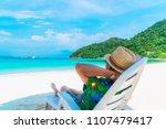asian man traveler relaxing on... | Shutterstock . vector #1107479417