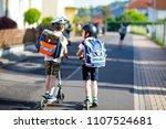 two school kid boys in safety... | Shutterstock . vector #1107524681