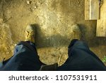 Small photo of Total work mode. heavy-duty tradesmen pants and boots ready for some hands on work.