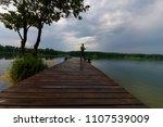 fisherman catching the fish... | Shutterstock . vector #1107539009