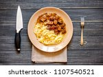 mashed potatoes with meat on a... | Shutterstock . vector #1107540521