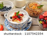 bowl of homemade granola with... | Shutterstock . vector #1107542354