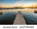wooden jetty in ala wai harbor... | Shutterstock . vector #1107549485
