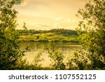 sunset over lake and blossoming ... | Shutterstock . vector #1107552125
