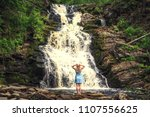 woman in hat enjoying nature... | Shutterstock . vector #1107556625