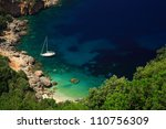 Stunning beach Kefalonia with a sailing boat moored up - stock photo