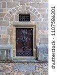 wooden door of black tower in...   Shutterstock . vector #1107586301