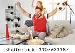 a family of fans watching a... | Shutterstock . vector #1107631187
