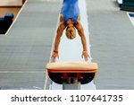 Small photo of sports gymnastics back athlete gymnast vault exercises