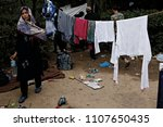 refugees and migrants in a... | Shutterstock . vector #1107650435
