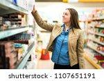 female customer holding package ... | Shutterstock . vector #1107651191