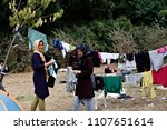 Small photo of Refugees and migrants in a makeshift camp at Pedion tou Areos park where some 1500 migrants and refugees live in a makeshift camps in Athens, Greece on Aug. 10, 2015