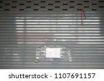 shop close old shutter roller...   Shutterstock . vector #1107691157