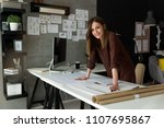 smiling businesswoman in her... | Shutterstock . vector #1107695867