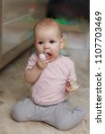 little girl with soother.... | Shutterstock . vector #1107703469