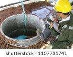 draw well plumber is working in ... | Shutterstock . vector #1107731741